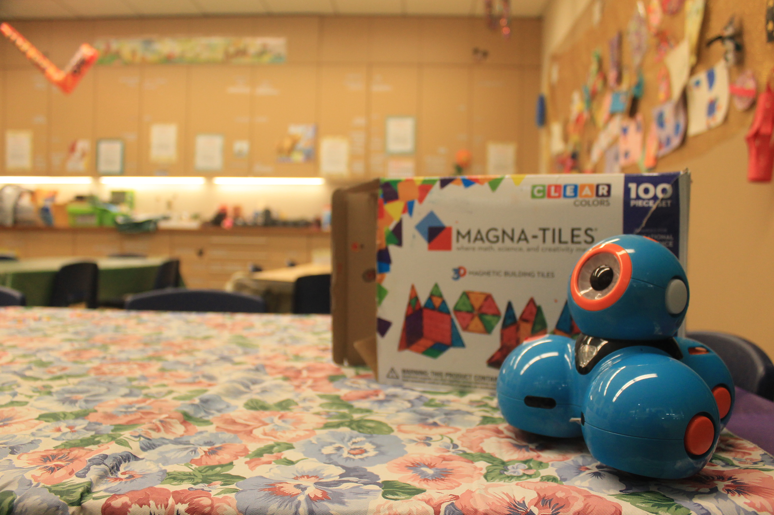 A Dash robot and Magnetiles in the Children's STEAM Center.